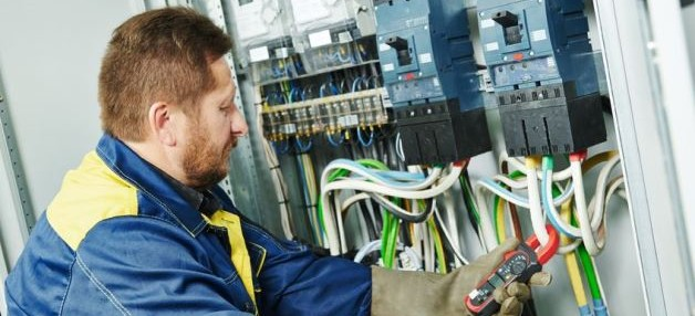 electrician checking circuit breaker